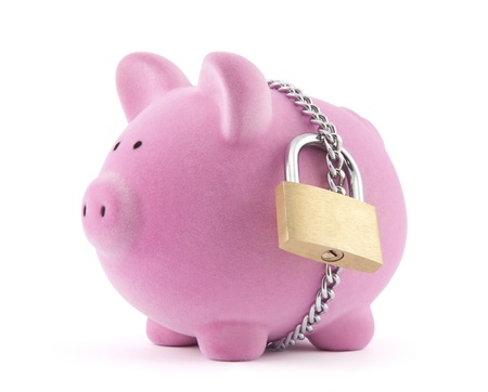 Piggy bank secured with padlock. Clipping path included.