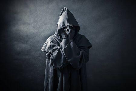 Foto de Ghostly figure in hooded cloak - Imagen libre de derechos
