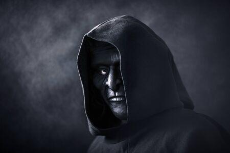 Foto de Scary figure in hooded cloak with mask - Imagen libre de derechos