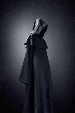 Foto de Scary figure in hooded cloak - Imagen libre de derechos