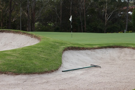 Golf bunkers with rake next