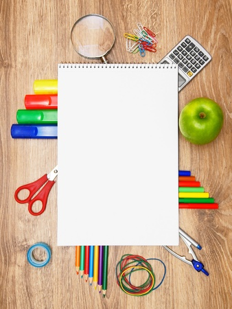 Back to school. School accessories on a wooden background.