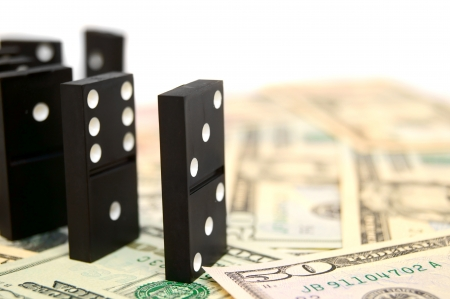 Dominoes on money  dollars