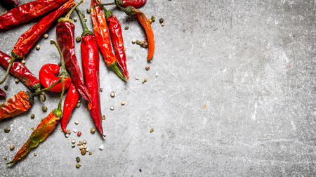 Red chili pepper dried. On a stone background. Free space for text . Top view