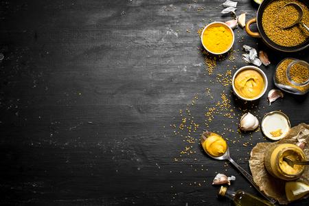 Ingredients for making mustard. On a black chalkboard.