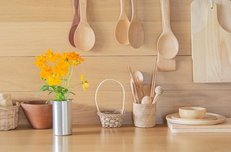 Photo for Fresh yellow flowers in the vase and kitchen - Royalty Free Image