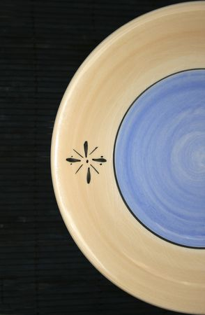 decorative ceramic plate on dark background