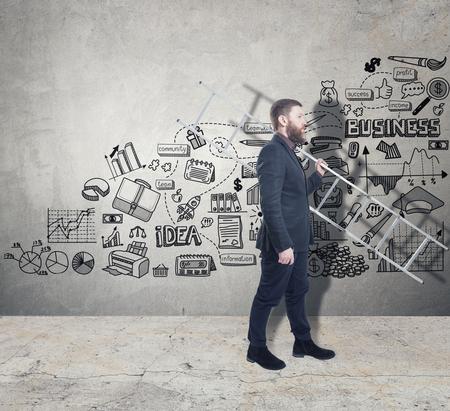 Photo pour Man with a ladder and a business plan on a concrete wall - image libre de droit