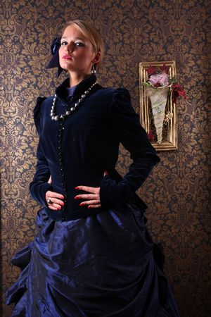 Young woman posing in victorian dress