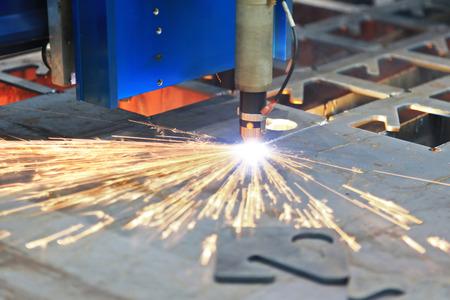 Laser cutting of metal sheet with sparks