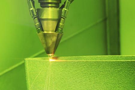 Foto per Laser sintering machine for metal. Metal is sintered under the action of laser into shape. DMLS, SLM, SLS. Modern additive technologies 4.0 industrial revolution - Immagine Royalty Free