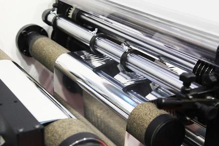 Photo pour Machine for the cutting of thin aluminum foil into strips - image libre de droit