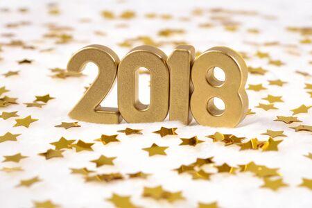 Photo pour 2018 year golden figures and golden stars on a white background - image libre de droit