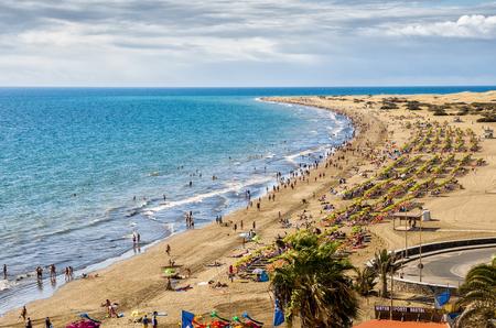 English beach on the island of Gran Canaria in Maspalomas dunes beside