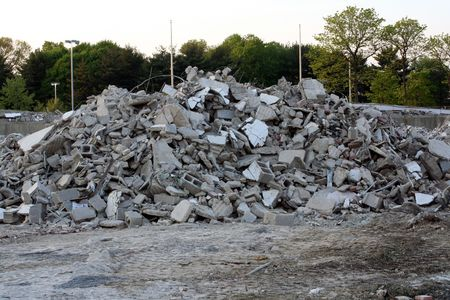 Pile of broken concrete and cinder blocks from a building demolition.