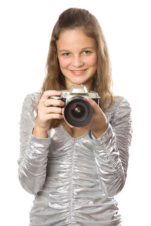 Young girl with SLR camera. Isolate oin white.