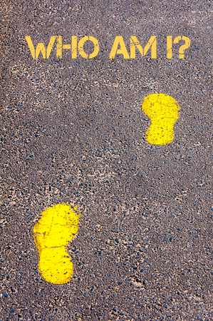 Yellow footsteps on sidewalk towards Who Am I message.Concept image