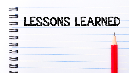 Lessons Learned Text written on notebook page, red pencil on the right