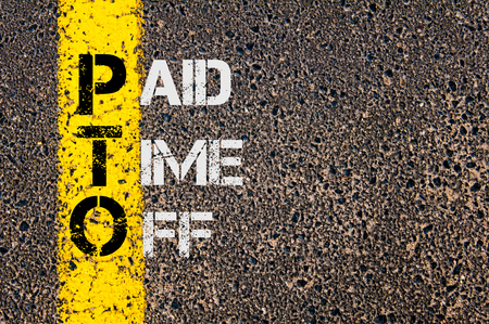 Concept image of Business Acronym PTO as Paid Time Off written over road marking yellow painted line.