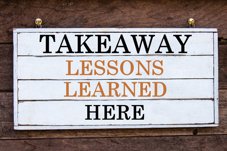 Takeaway Lessons Learned Here Inspirational message written on vintage wooden board. Motivation concept image