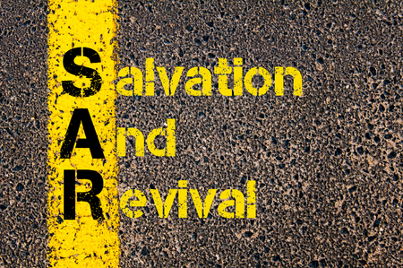 Concept image of Accounting Business Acronym SAR Salvation And Revival written over road marking yellow paint line.