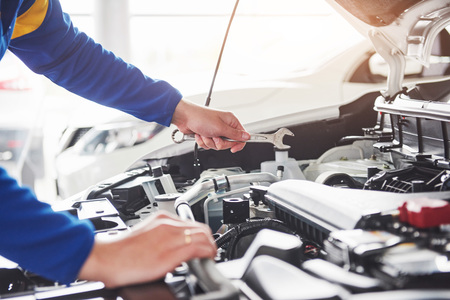 Foto de Hands of car mechanic with wrench in garage. - Imagen libre de derechos