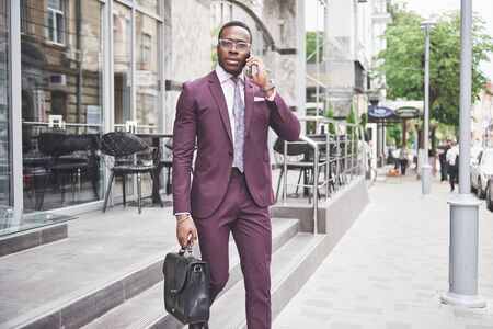 Photo pour Portrait of a young beautiful African American businessman with a briefcase. Business meeting - image libre de droit