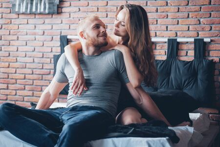 Photo for Attractive young lovers have a couple playing together in bed - Royalty Free Image