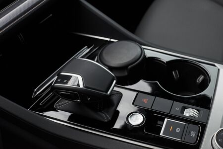 Photo pour A fragment of the modern car saloon and a gearbox in an expensive car - image libre de droit