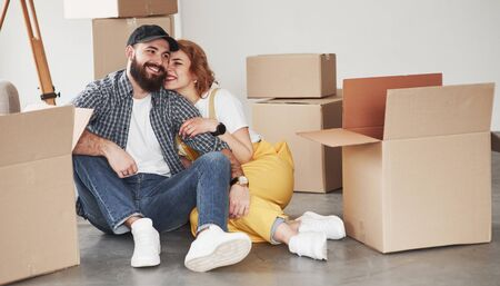 Photo for Enjoying beeing together. Happy couple together in their new house. Conception of moving. - Royalty Free Image