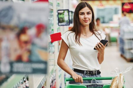 Photo pour Modern mall. Female shopper in casual clothes in market looking for products. - image libre de droit