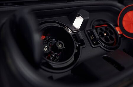 Foto de Charging inputs of brand new electrical car. Modern fuel. Conception of ecology. - Imagen libre de derechos