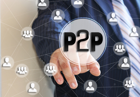 The businessman chooses the P2P,  Peer to peer on a touch screen. Peer to peer lending concept.