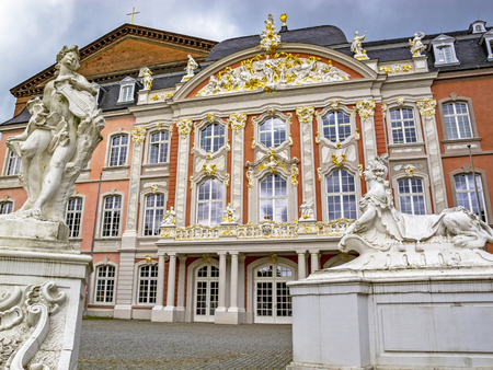 TRIER, GERMANY - OCTOBER 16, 2014: Statues of Apollo and a Sphinx by Ferdinand Tietz in front of the Electoral Palace, Kurfuerstliches Palais and the Aula Palatina, Konstantinbasilika in the oldest German city
