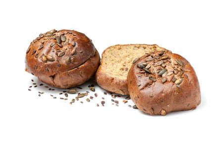 Foto für Sliced baked bread rolls with pumpkin seeds and sesame isolated on white background. Half sandwich bun with crisp. - Lizenzfreies Bild