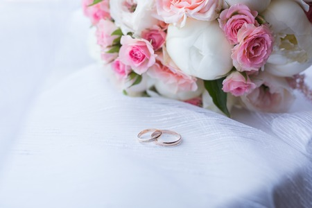 Two wedding rings and spring blossoms. Wedding concept.