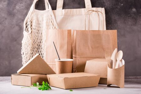 Photo for Food eco packaging made from recycled kraft paper. Flat lay concept of environmental protection, nature conservation, recycle, zerp waste. Eco-friendly dishes - Royalty Free Image