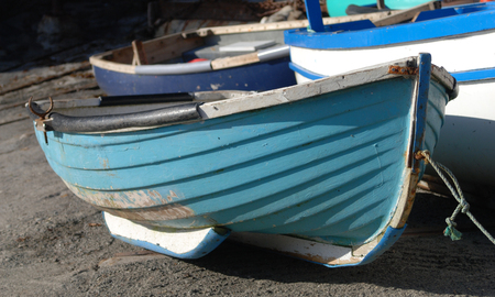 Brightly coloured fishing vessels in Cornwall, England