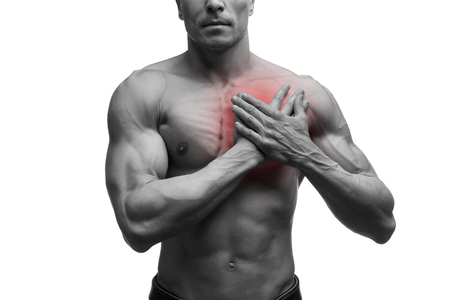 Heart attack, middle aged muscular man with chest pain isolated on white background, black and white photo with red dot