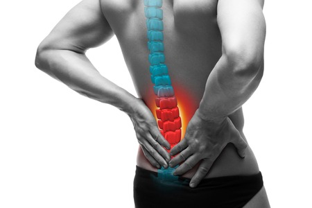Foto de Pain in the spine, a man with backache, injury in the human back, chiropractic treatments concept isolated on white background with highlighted skeleton - Imagen libre de derechos