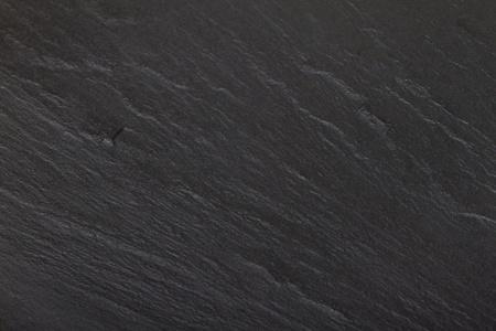 Dark grey / black slate or rock background or texture.