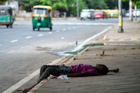 Photo for Poor Homeless man sleeping on sidewalk in New Delhi, India - Royalty Free Image