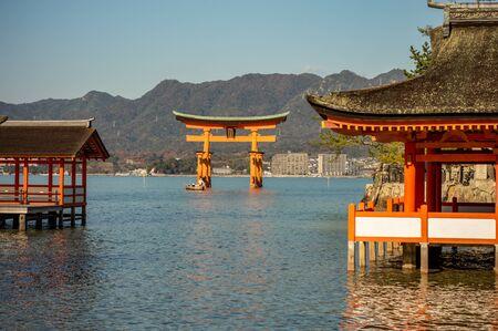 Photo for Itsukushima Shinto Shrine in Miyajima island with its floating red torii gate Japan - Royalty Free Image