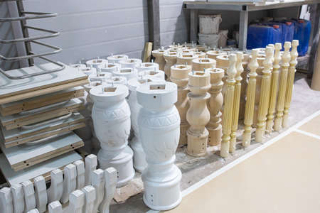 Photo pour Painted wooden table legs. Beautiful professionally made one-piece beech leg in the production process in the workshop. Furniture manufacturing. - image libre de droit