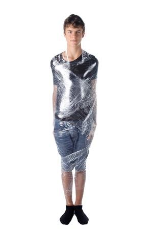 boy shrinkwrapped on cellophane on white