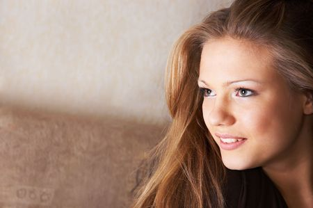 portrait of pretty young woman with sidelong glance and scarcely perceptible smile