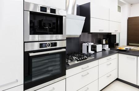 Photo pour Modern luxury hi-tek black and white kitchen interior, clean design - image libre de droit