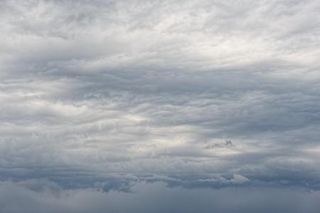 Background of strange looking dark heavy overcast clouds