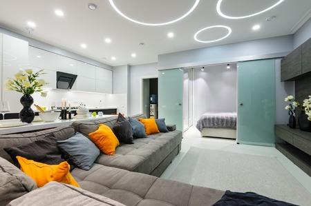 Photo pour Modern white living studio with bedroom doors open - image libre de droit