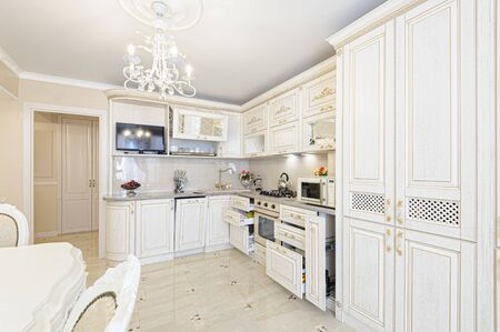 Photo pour Luxury modern beige and cream colored kitchen interior - image libre de droit